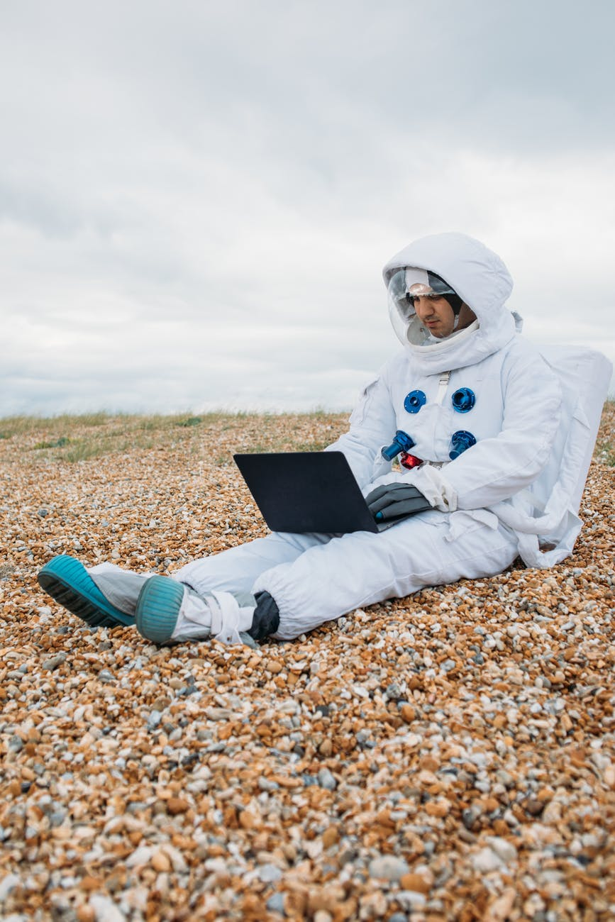 astronaut using a laptop