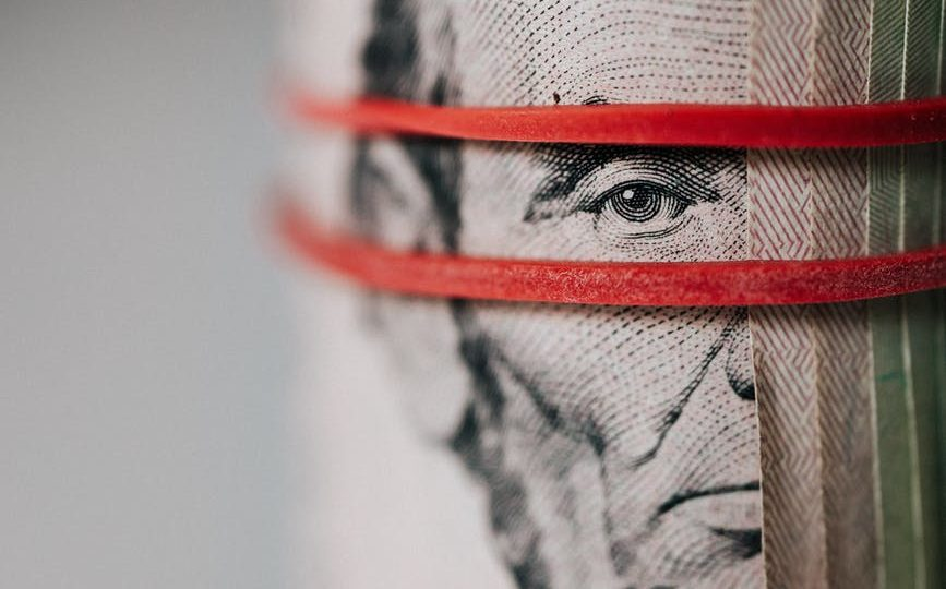 roll of american dollar banknotes tightened with band
