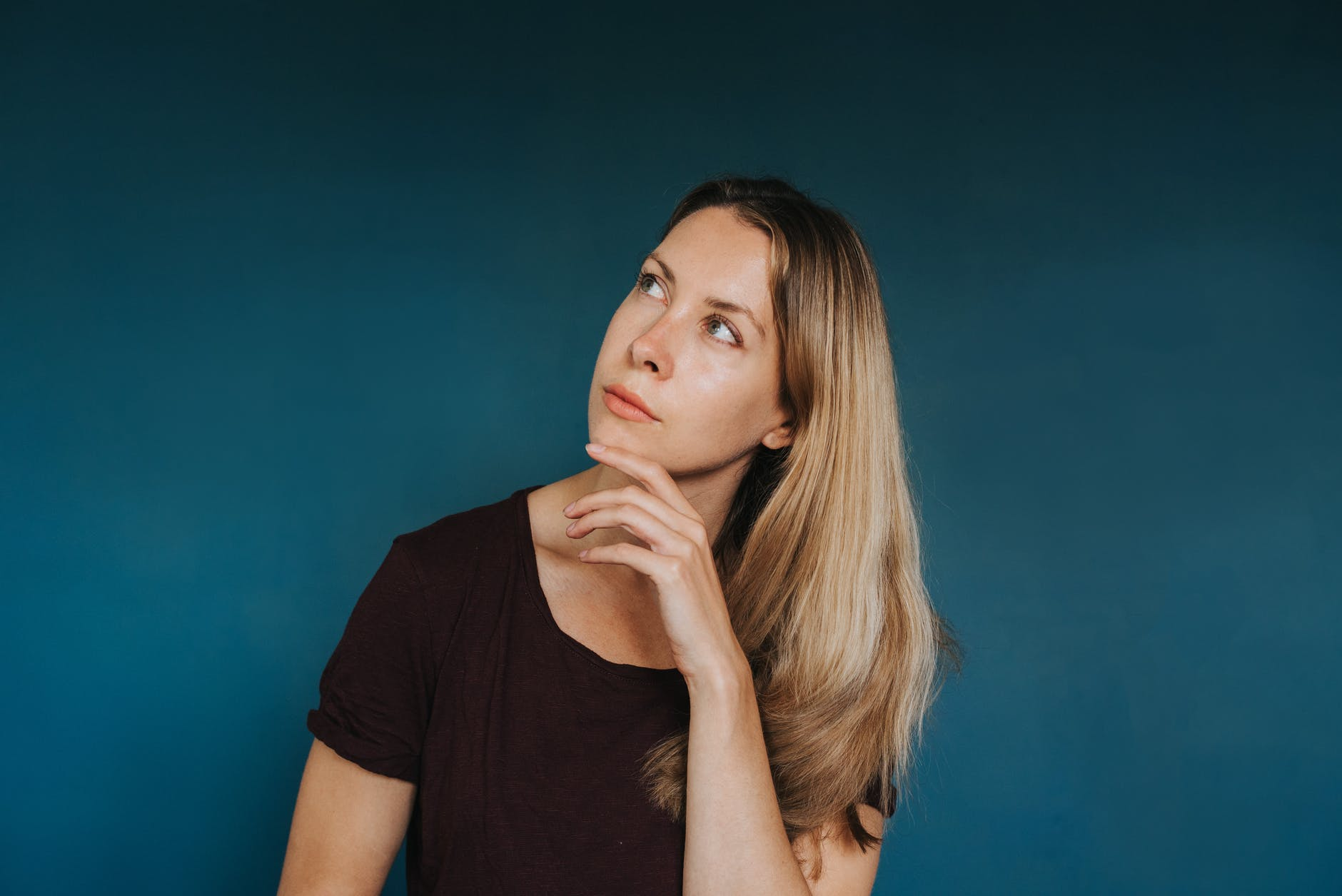 dreamy woman standing against blue background